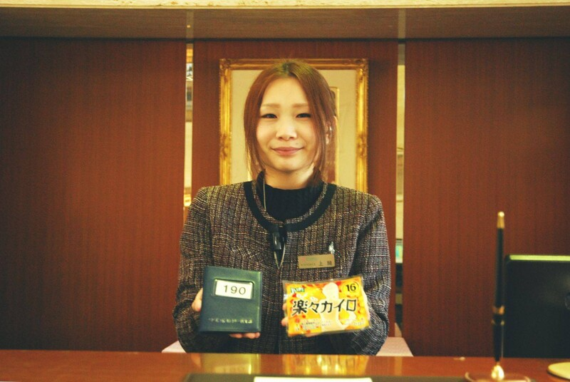 A woman at reception at a golf course clubhouse in Japan. What are golf clubhouses like in Japan?